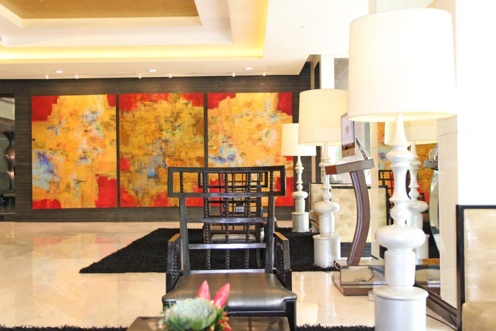 lobby of the bellevue hotel manila with painting best hotel in alabang